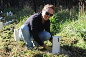 A NAB volunteer planting at the Wetlands in Yea